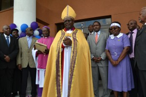 Archbishop Dr. Timothy Ndambuki speaking during the opening of Imani II plaza.