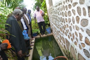 Bishop Samwel Kitula showing OAIC leaders his fish pond at his home in Mwanza.